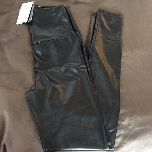 """Shiny Black Faux Leather Leggings These shiny faux leather leggings have a flattering high waist and measure 28.5"""" on the inseam. The label says Small size 26 but I think since the smallest part of the waist measures only 22"""", even though it has a lot of stretch, it is more like an XS Pants Leggings"""