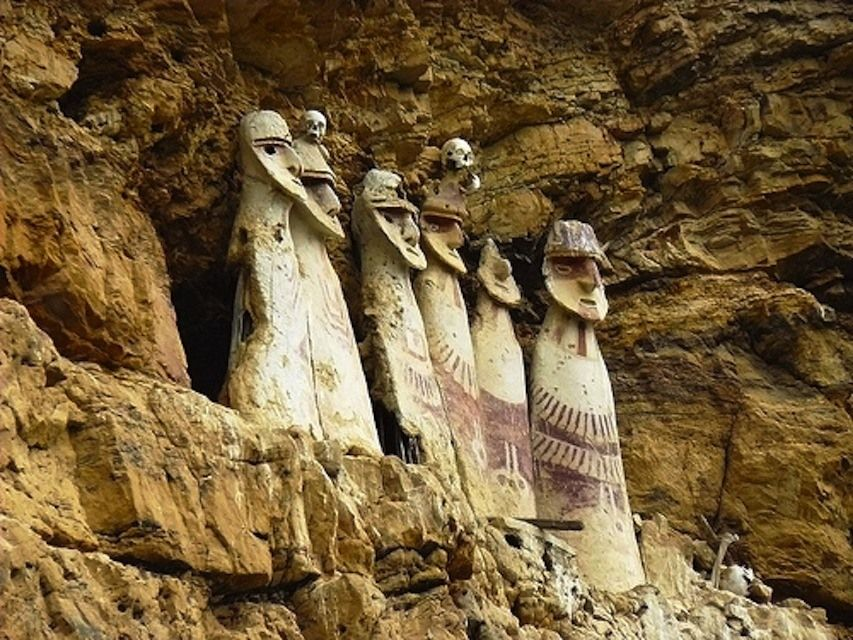 These giant mummies are set ominously into a Peruvian cliffside and topped with real human skulls.
