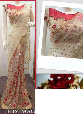 Hey, check out Cream embroidered net saree with blouse on Mirraw! https://bnc.lt/zjMh/DixDp2feXG?product_id=1581960