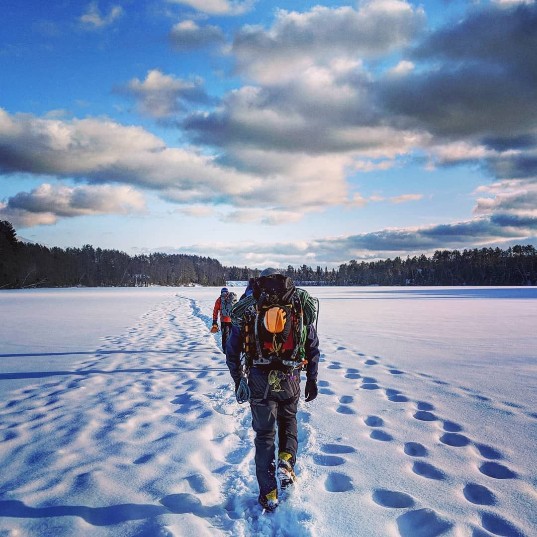 Hiking on the 'safe line' across a frozen lake after an
