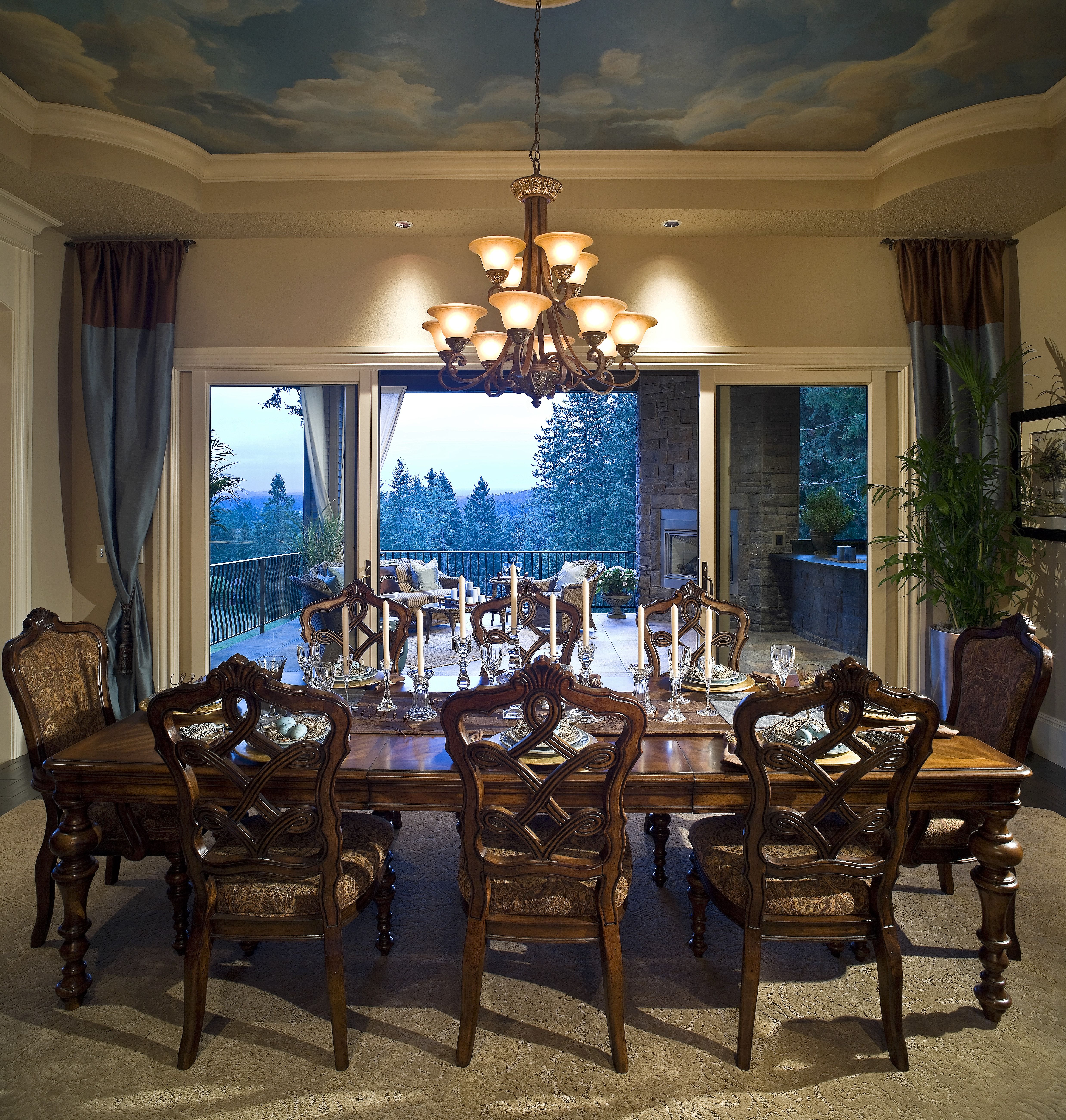 This large dining room has a beautiful view through ...