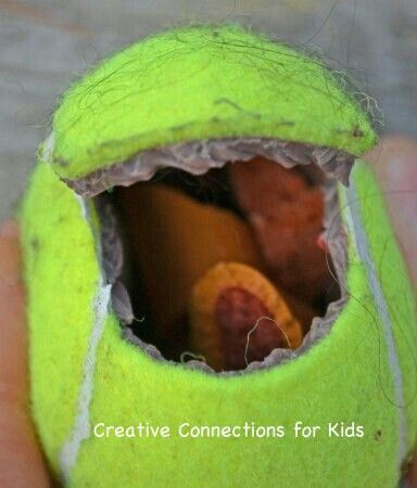 cut open tennis ball put smaller toys or colorful cloth inside - why is there fuzz on a tennis ball