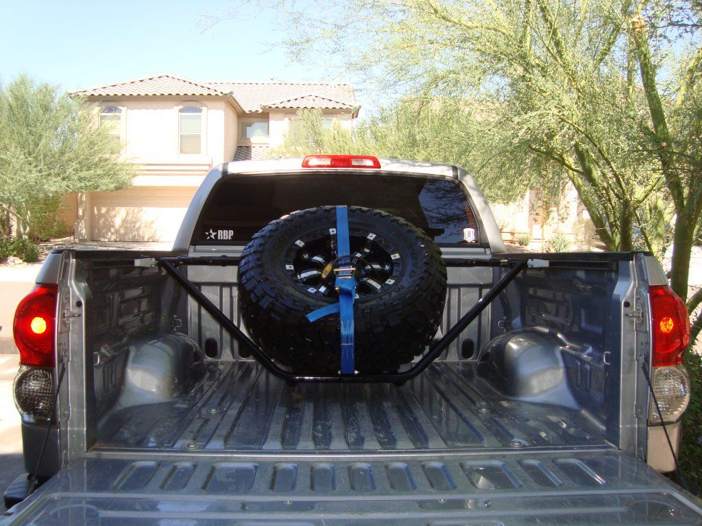 Here s the n fab spare tire carrier that mounts in the toyota tundra factory bed rail system