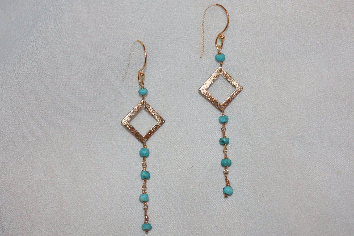 Modern Dangling Turquoise Gem & Gold Square Design Earring is part of Turquoise jewelry outfit, Turquoise jewelry boho, Turquoise stone jewelry, Turquoise jewelry, Special jewelry, Modern earrings - 2 inches hanging length from hook Materials Stabilized Turquoise gemstones, 18kt gold vermeil chain, Earring Hook 22kt gold vermeil Clasp Lobster Claw 18kt gold vermeil Packaging Organza bag in gift box with cotton and ribbon