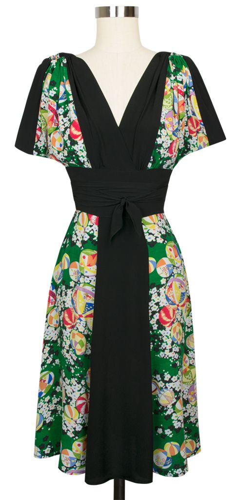 The Obi Dress in Green Kimono features a contrasting black center panel and waist with ties.