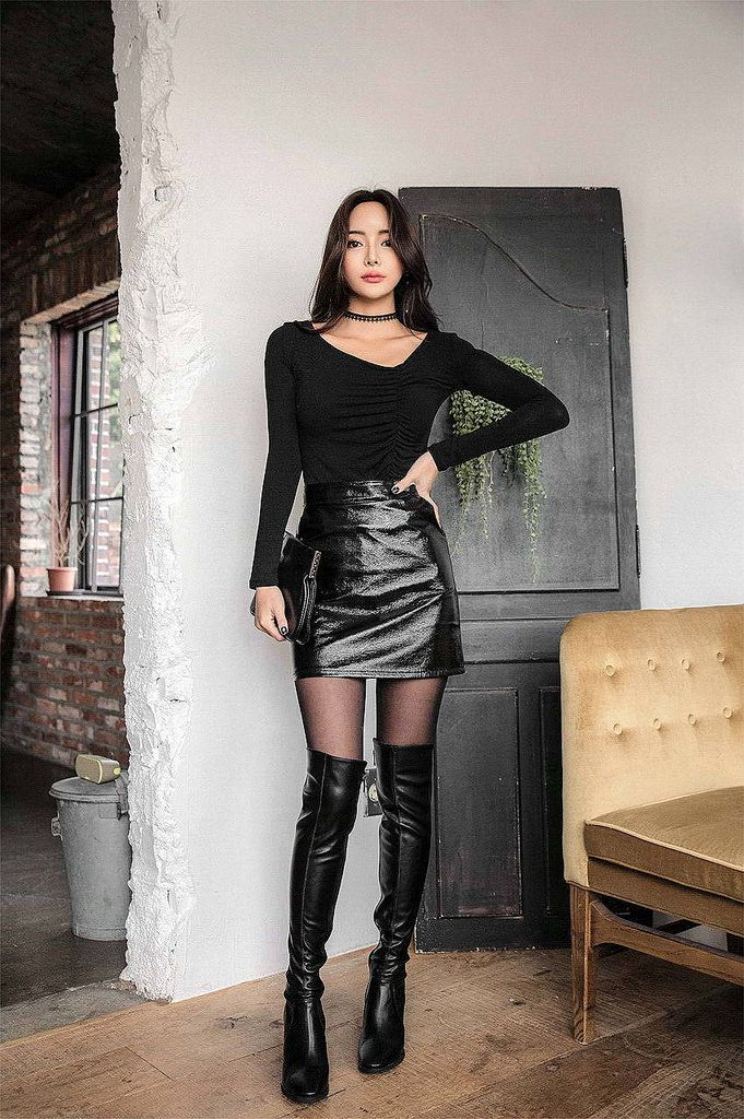 black thigh high boots on black pantyhose with short mini