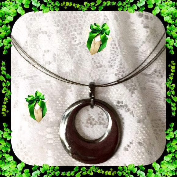 HEMATITE CIRCULAR NECKLACE   . This authentic Hemetite stone necklace has a trendy circular shape.  It is on a jewelers moldable wire neck chain.   Jewelry Necklaces