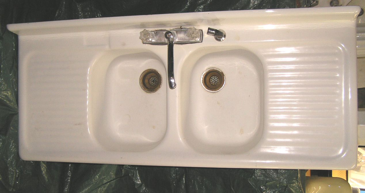 she has a beautiful cast iron double sink with the drain