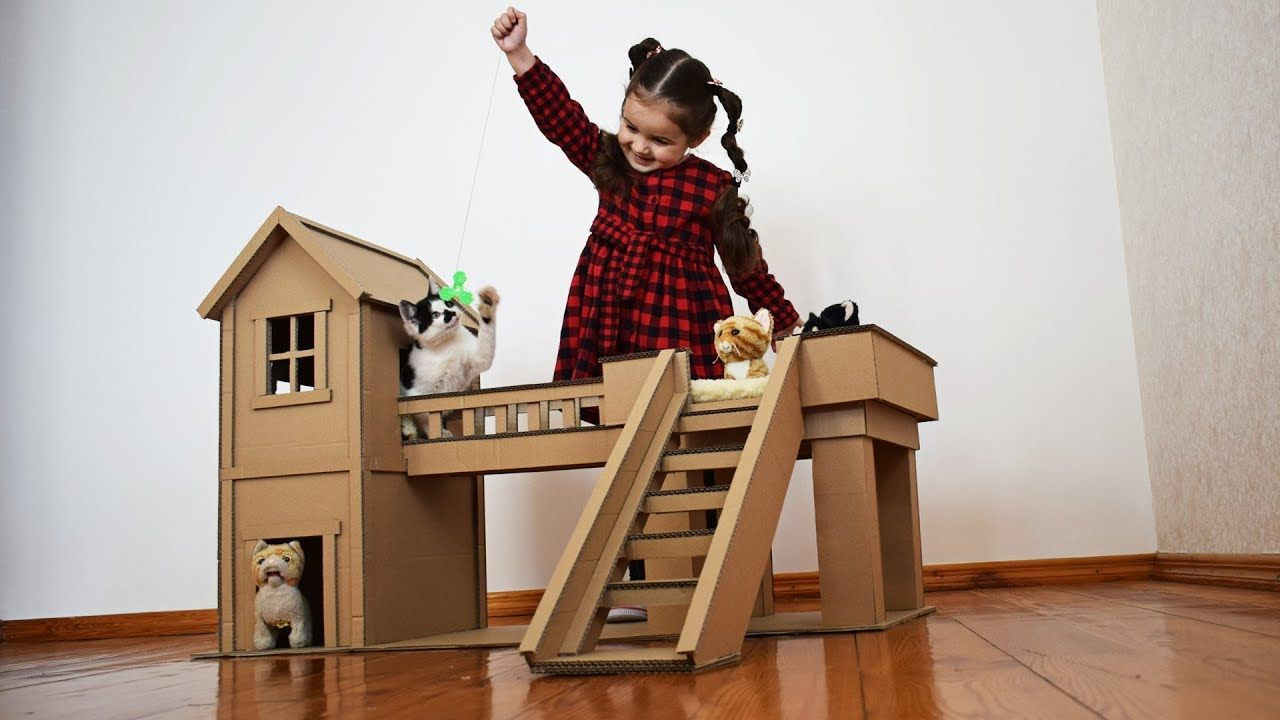 A cat house out of cardboard box with images
