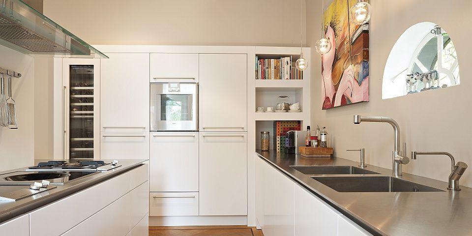 Moderne keuken met witte MDF fronten in Zeist
