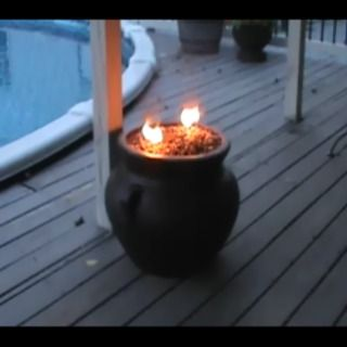The flower pot fire pit flower tiki torches and gardens for Flower fire pit