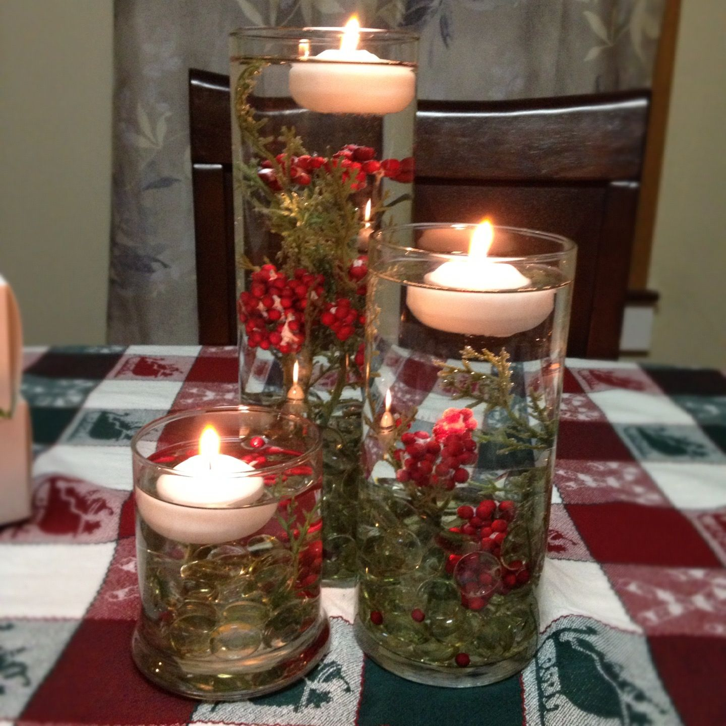 Holiday Centerpiece With Floating Candles I Found The Smaller Two Glasses Th Christmas Candle Centerpieces Holiday Table Decorations Candle Table Decorations