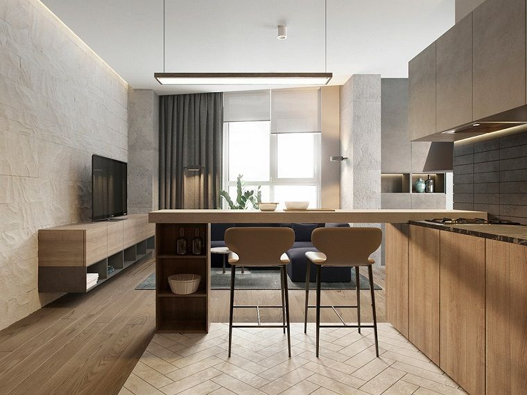 Open space cucina soggiorno con isola e sgabelli alti pavimento in