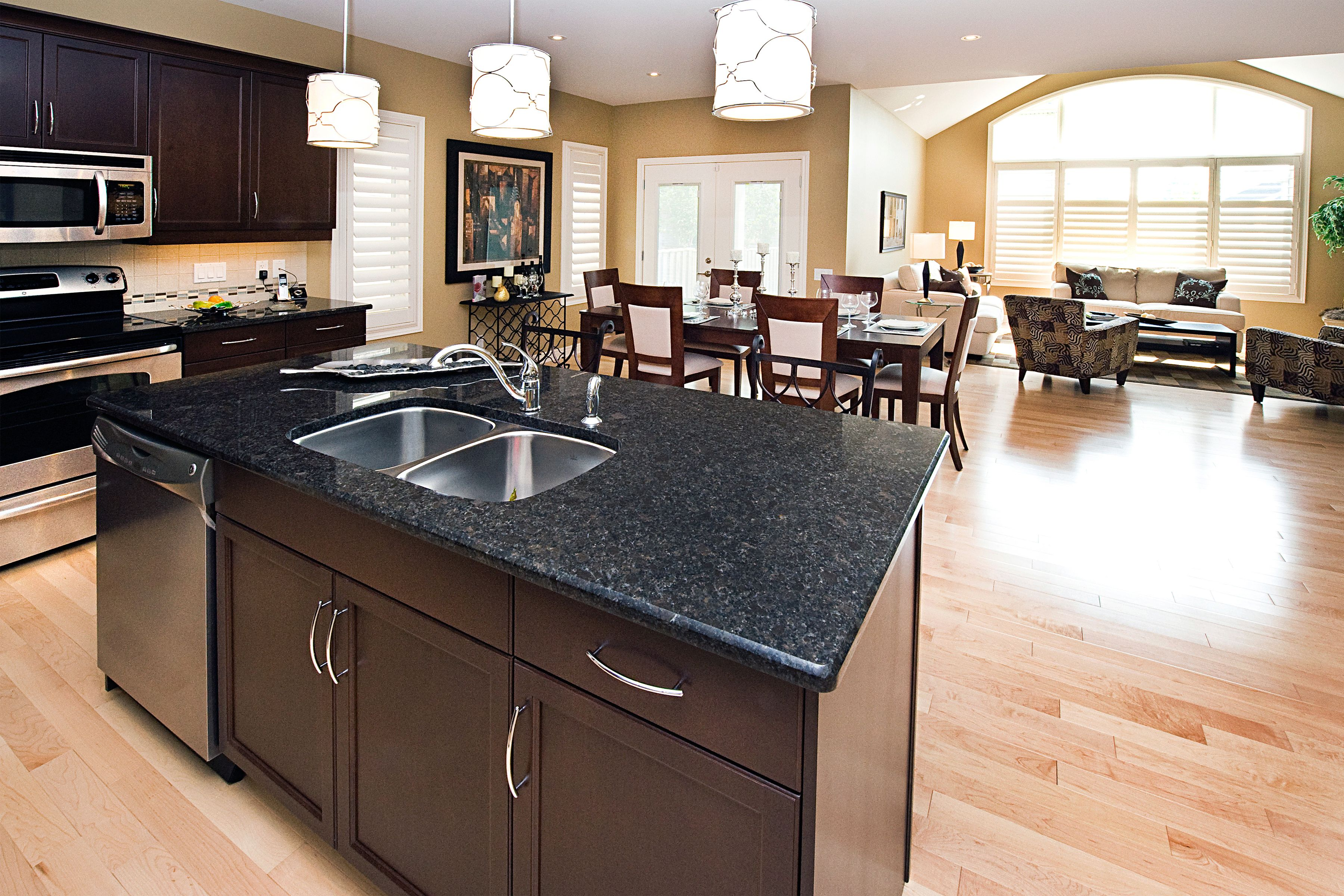 The Newport Kitchen   Granite Breakfast Bar, Pendant Lights, Hardwood  Floors, Large Windows