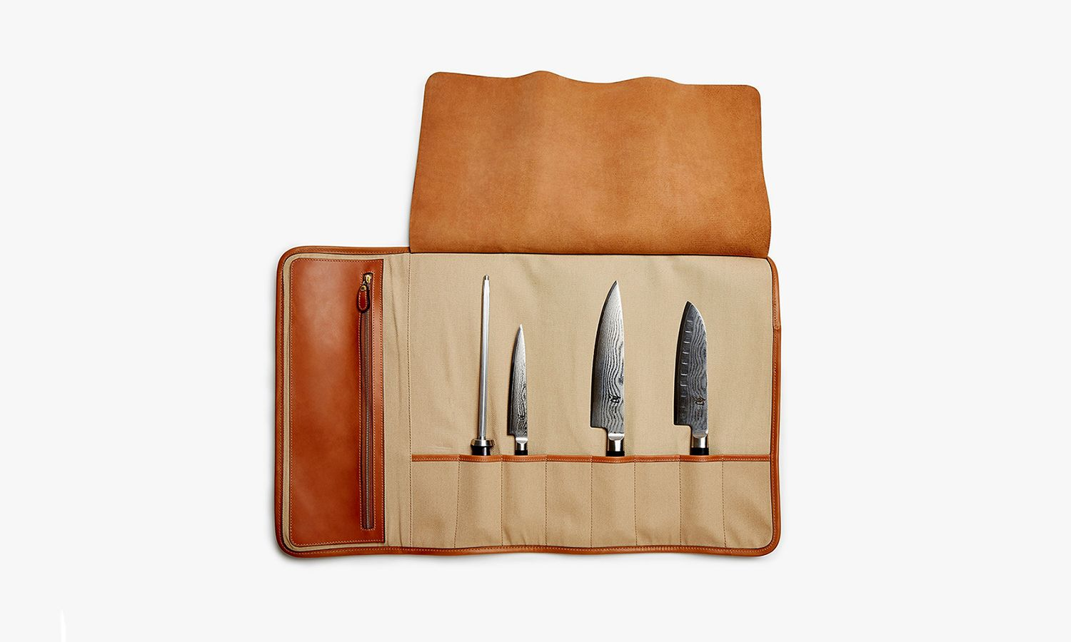 Ghurka delve into the culinary world with this leather Chef's Knife Roll featuring space for 8 knives, post and tab buckle closures and a leather handle.