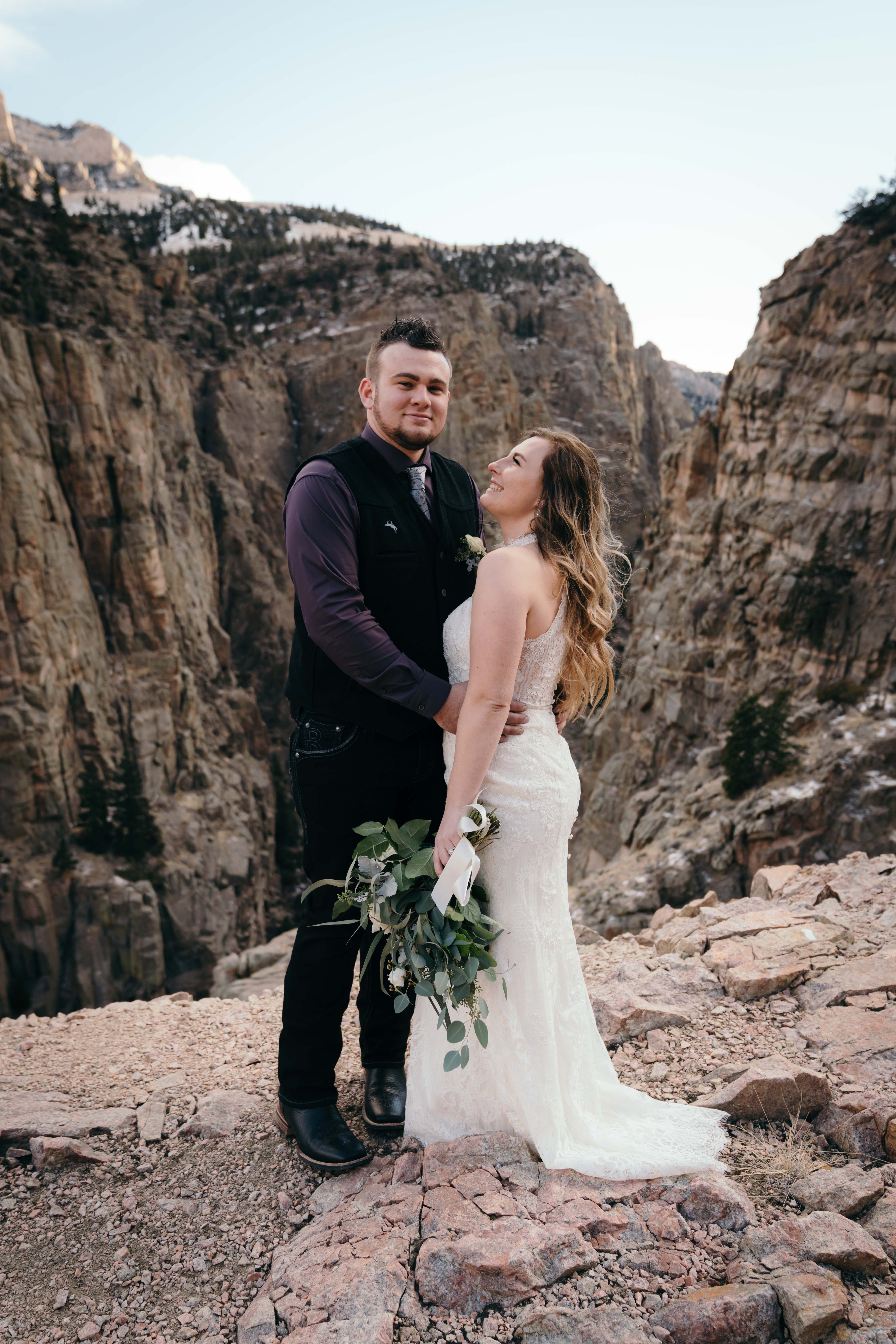 Canyon Views For This Bride Groom At Their Winter Wedding In Cody Wyoming Wyoming Weddings Rustic Winter Wedding Bride Groom