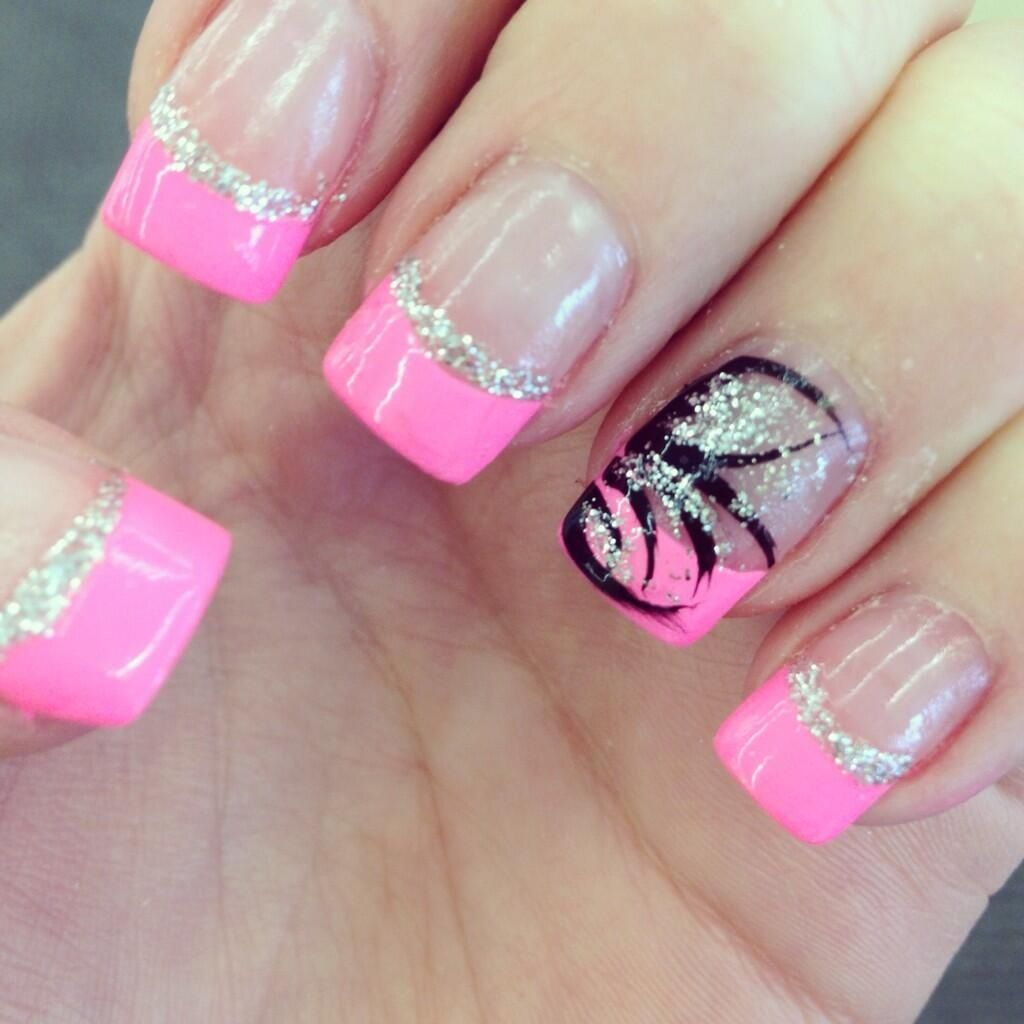 Pink French tips with silver glitter and design on ring finger ...