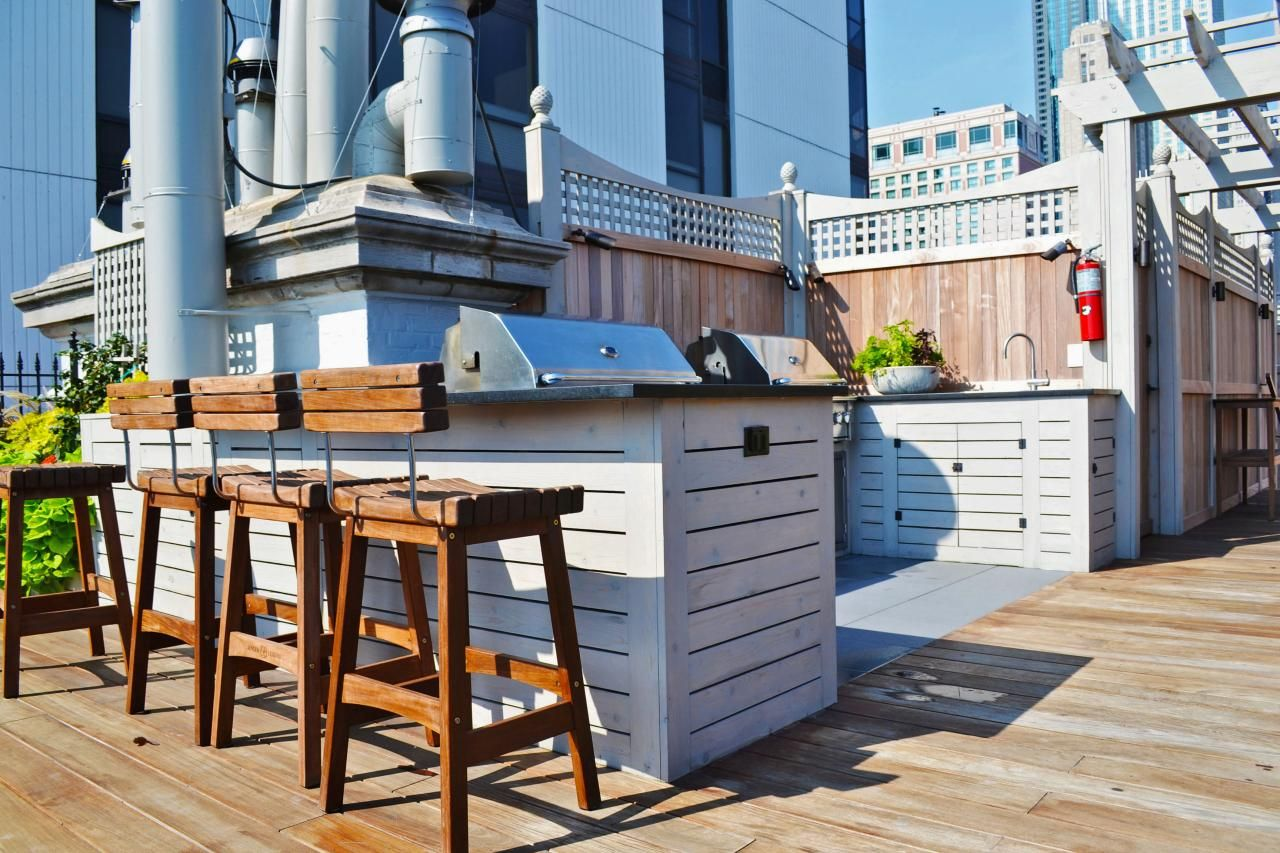 Contemporary Roof Deck With Wooden Barstools and Outdoor Bar ...