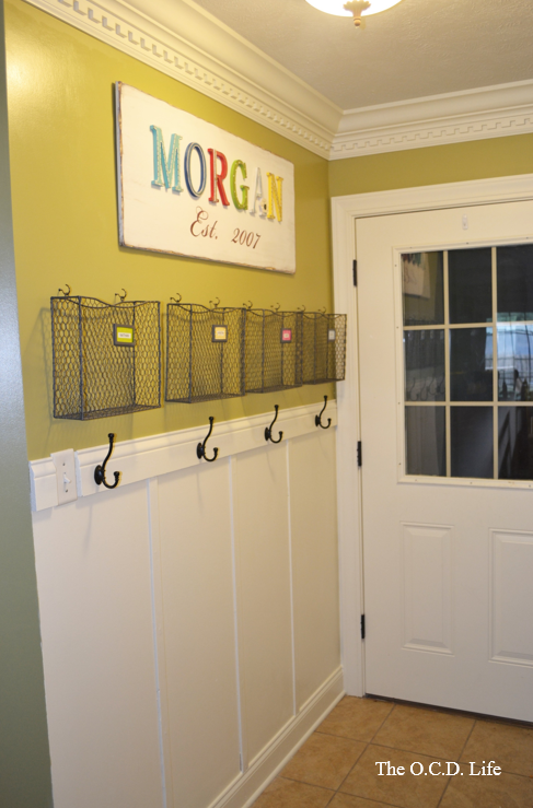 I like the baskets above the hooks.  I need this for my homework station.
