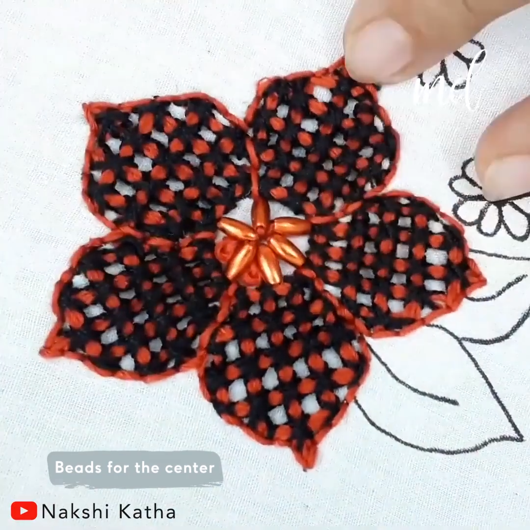 This checkered flower design is beautifully embroidered!