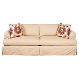 """Curl up with a mug of tea and your favorite read on this cozy sofa, featuring skirted cotton upholstery and complementing pillows for added comfort.   Product: SofaConstruction Material: Cotton, down-blend fill, engineered wood and woodColor: TanFeatures:  Down-blend cushionsTwo accent pillows includedDimensions: 29"""" H x 93"""" W x 41"""" DAssembly: No assembly required"""