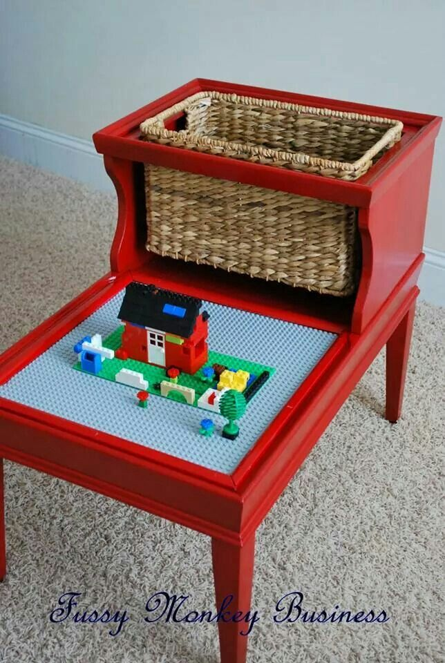 DIY Lego table has storage and lay space.  Perfect tucked away play area for a grandma's or uncle's house.