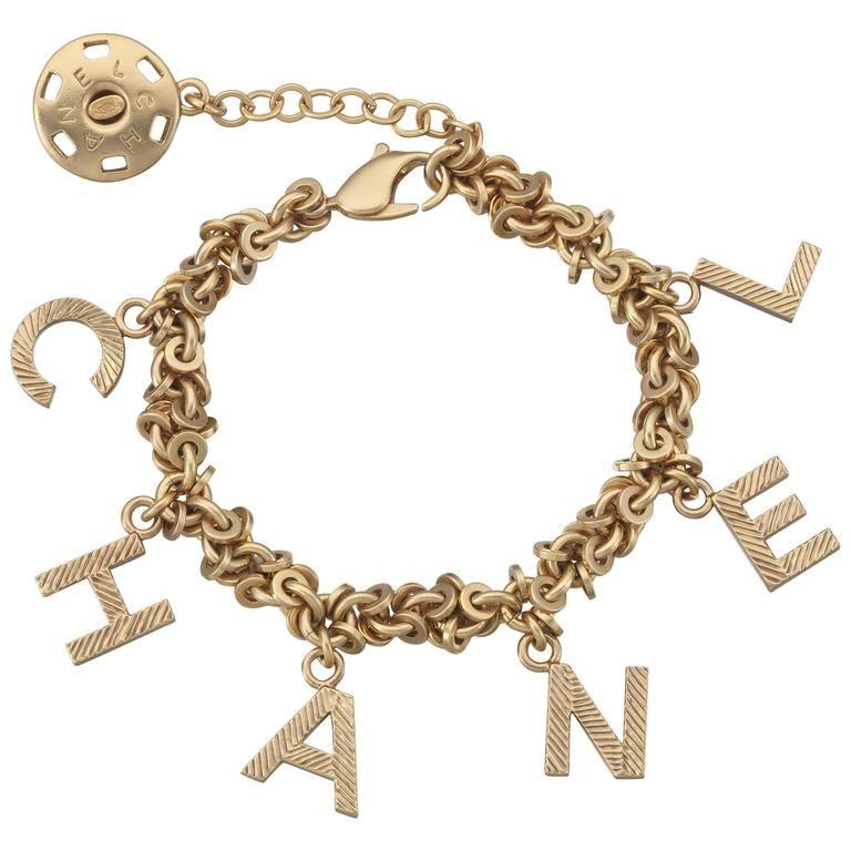 4711bac44a00e 2003 Chanel Gold Tone Link Charm Bracelet Spelling
