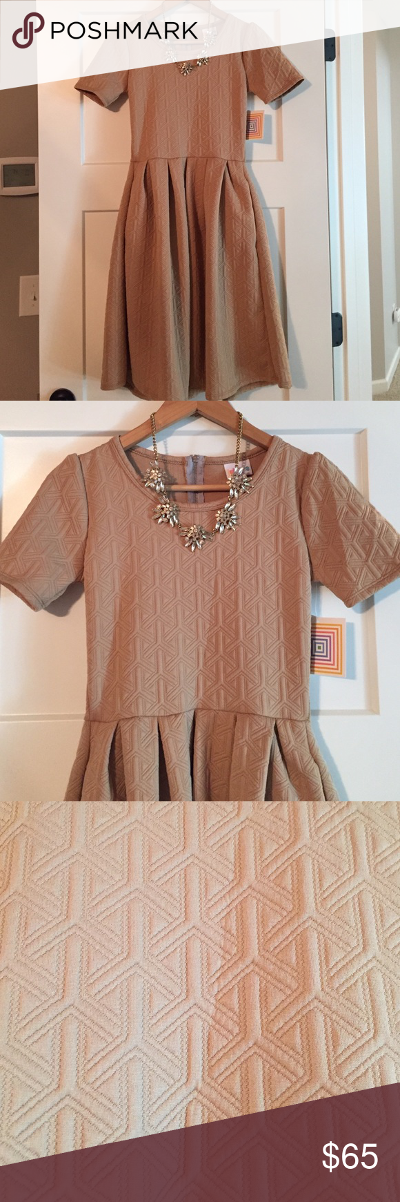 NWT XS tan LulaRoe Amelia dress with pockets This thicker material LulaRoe Amelia dress is NWT and has a gorgeous pattern on the material! It is 96% polyester and 4% spandex. It zips up the back, has pockets, and is super flattering! LuLaRoe Dresses