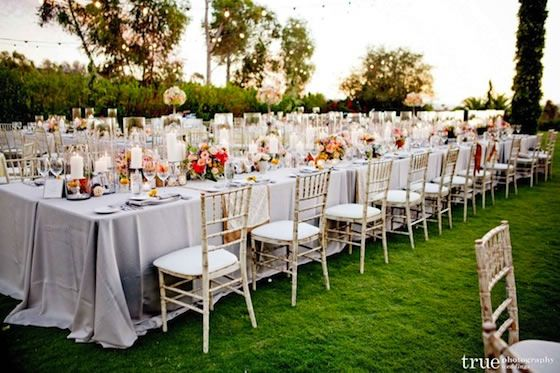 Long family-style tables and gold Chiavari chairs look so elegant ...