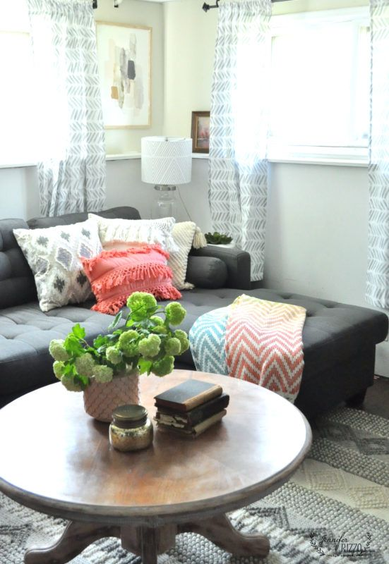 Gray and coral family room with smaller sectional