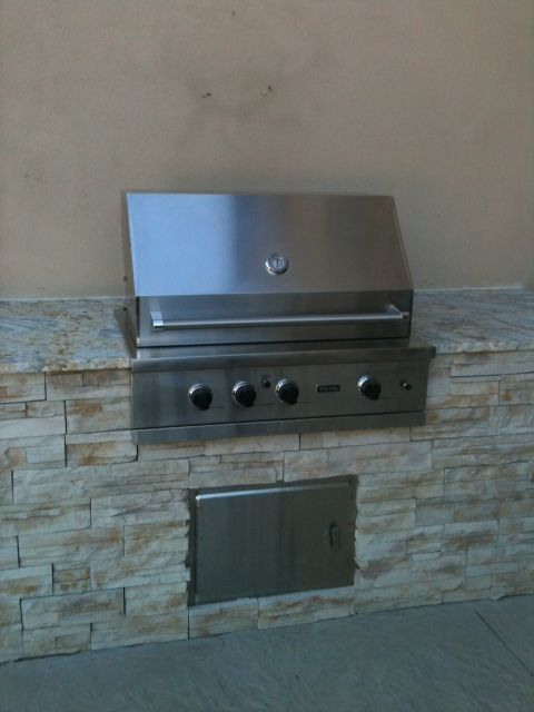 Stone veneer BBQ with leather finished granite by Tuscany Builders