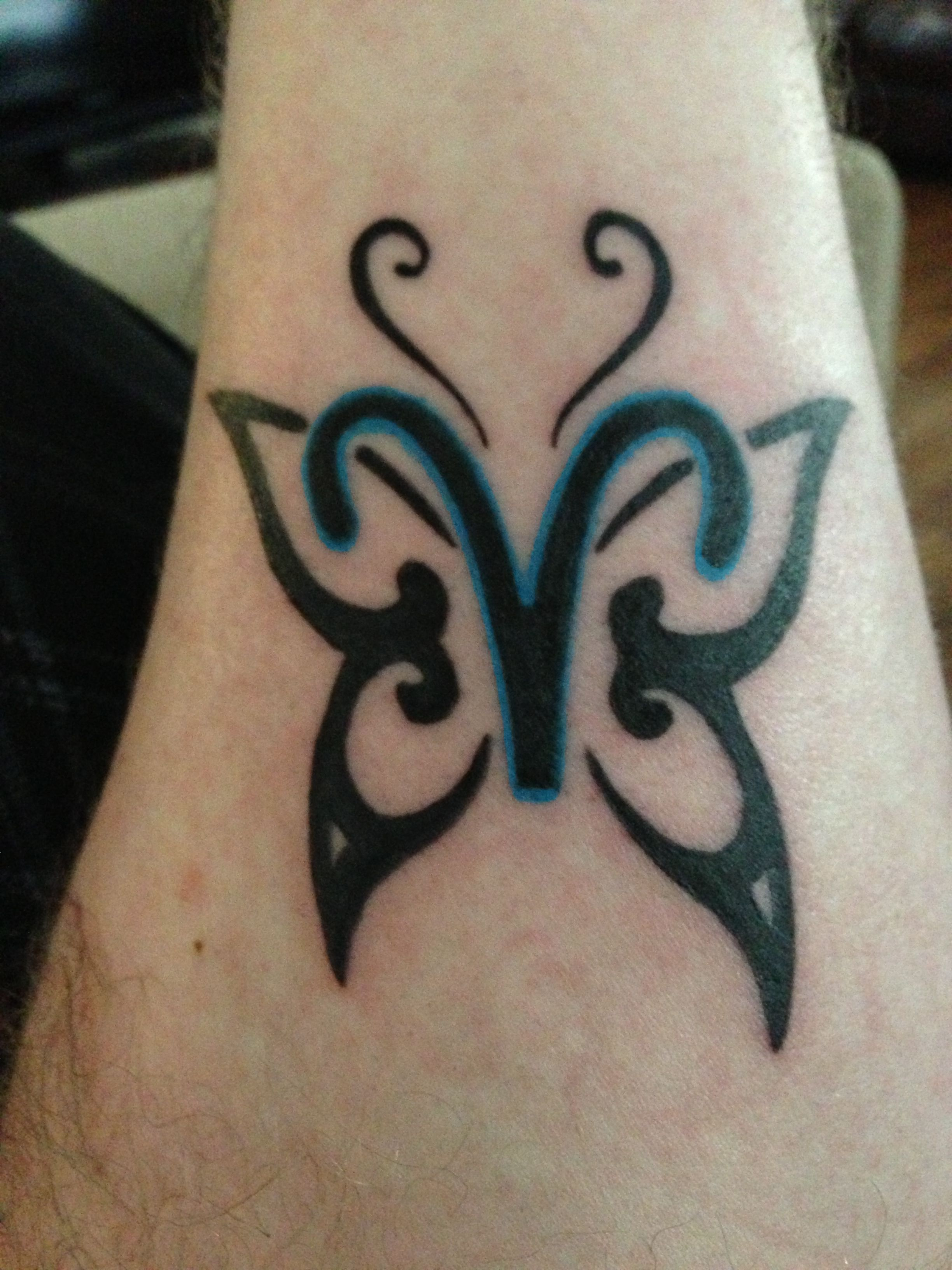 Pisces / Aries Cusp Tattoo! Nice   looks like a butterfly