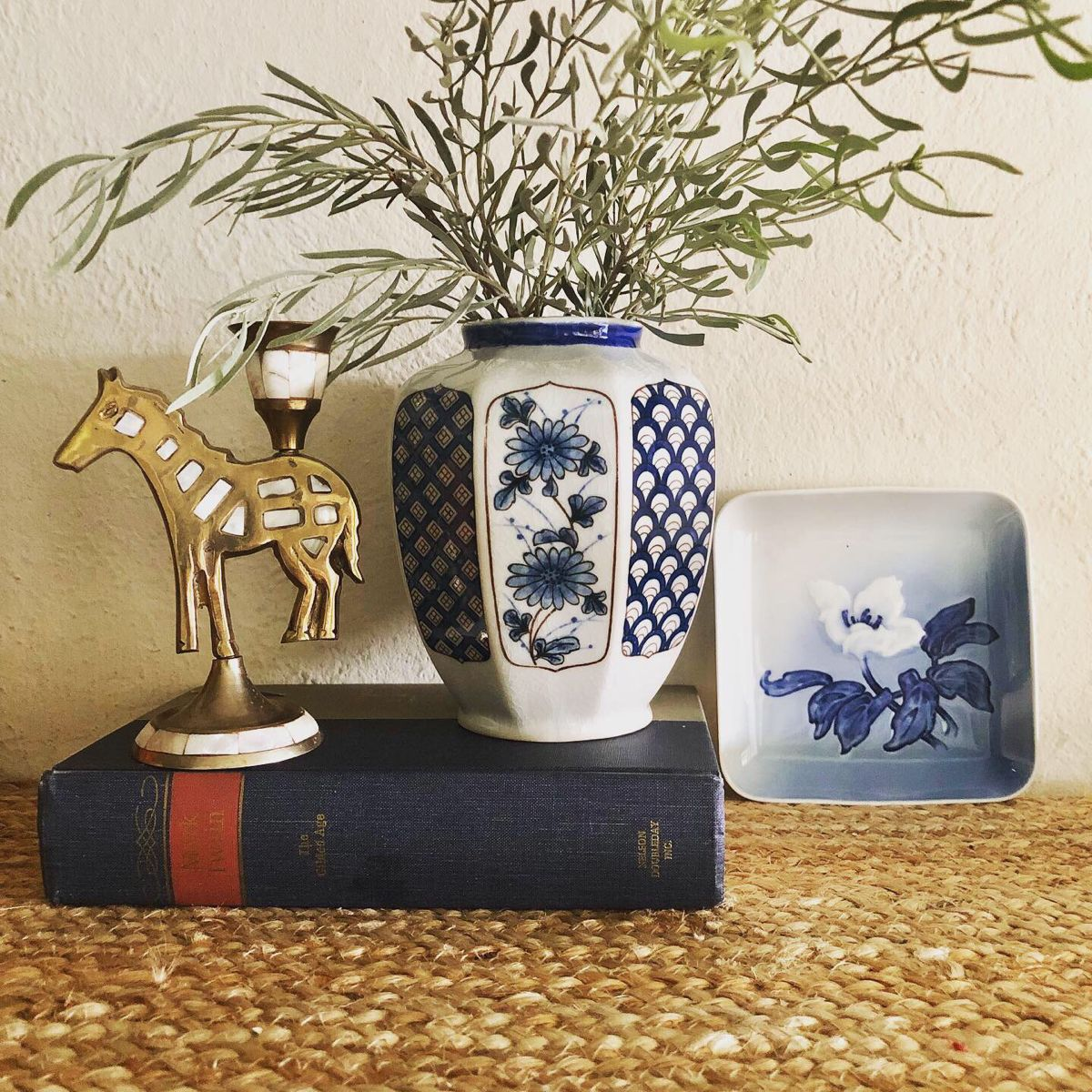 We just added these pretty blue and white pieces to our shop! The vase has alternating patterns on each side and it beautiful on its own or with flowers. The Bing and Grondahl plate is perfect holding jewelry or as a little soap dish. Everything is in our Spike and Daisy Etsy shop! #blueandwhite #blueandwhitedecor #bluedecor #vintagehomedecor #shelfdecorating #coffeetabledecorating #vintagestyle #vintagehome #etsyshop