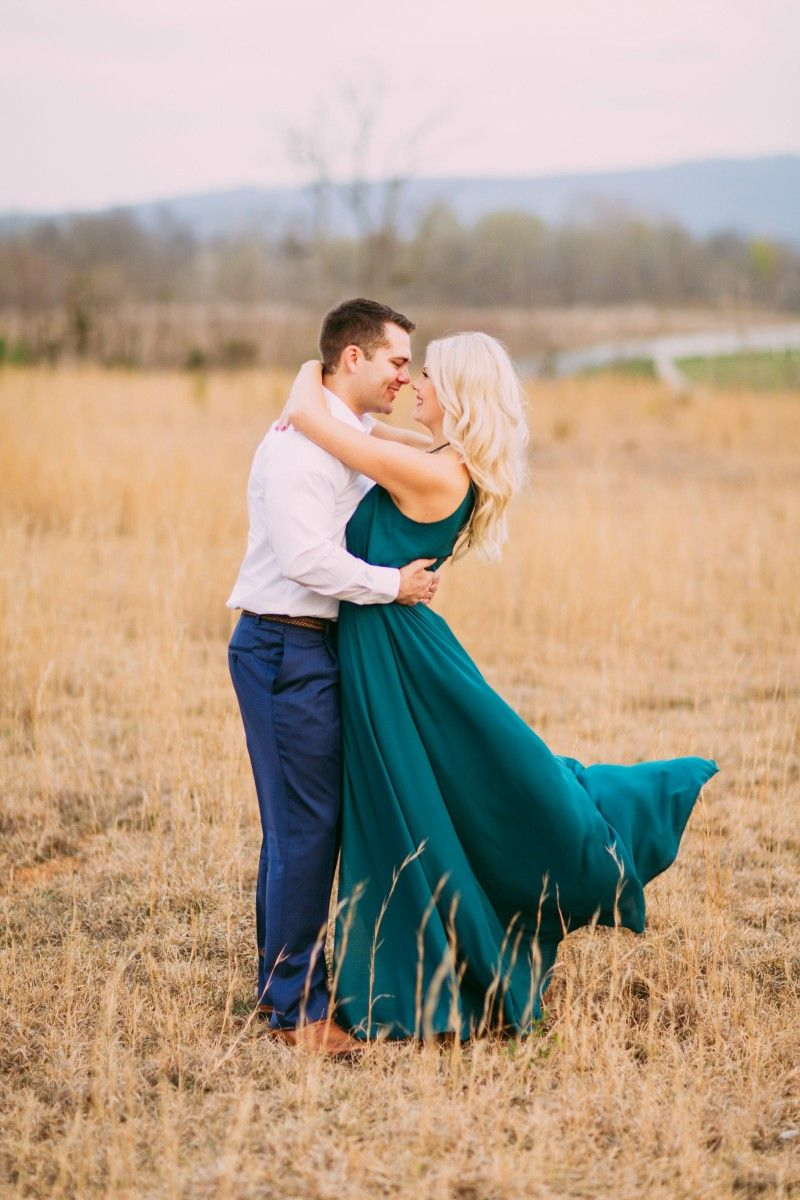 Kalee S Beautiful Long Dress Flowing In The Wind Makes The Engagement Photo Engagement Picture Outfits Engagement Photo Outfits Dresses For Engagement Pictures