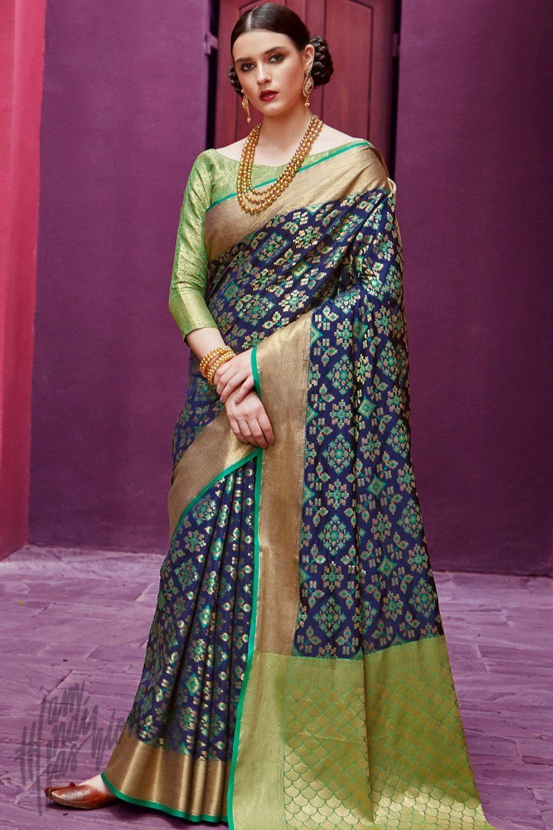 25f9a4a09a Blue and Green Silk Saree. The blue self weaving silk saree in ethnic  floral pattern is designed with green border with ethnic pattern and comes  with ...