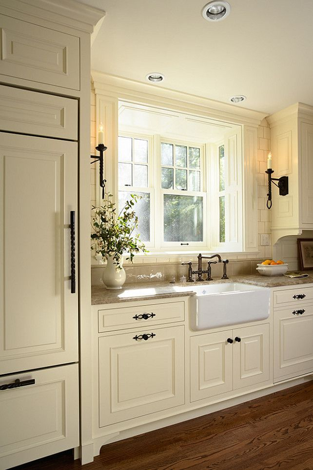 White Kitchen With Dark Wood Floor Designs from @hgsphere. Love the drawer pulls & the lights to the sides of the sink.