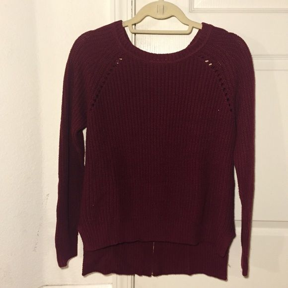 F21 Knitted Sweater with Zipper An oversized burgundy knit sweater from Forever 21 with a gold zipper on the back. The back is slightly longer than the front and there are slits on the sides of the sweater also. I've worn it a few times and have washed it but it's still in good condition. Forever 21 Sweaters Crew & Scoop Necks