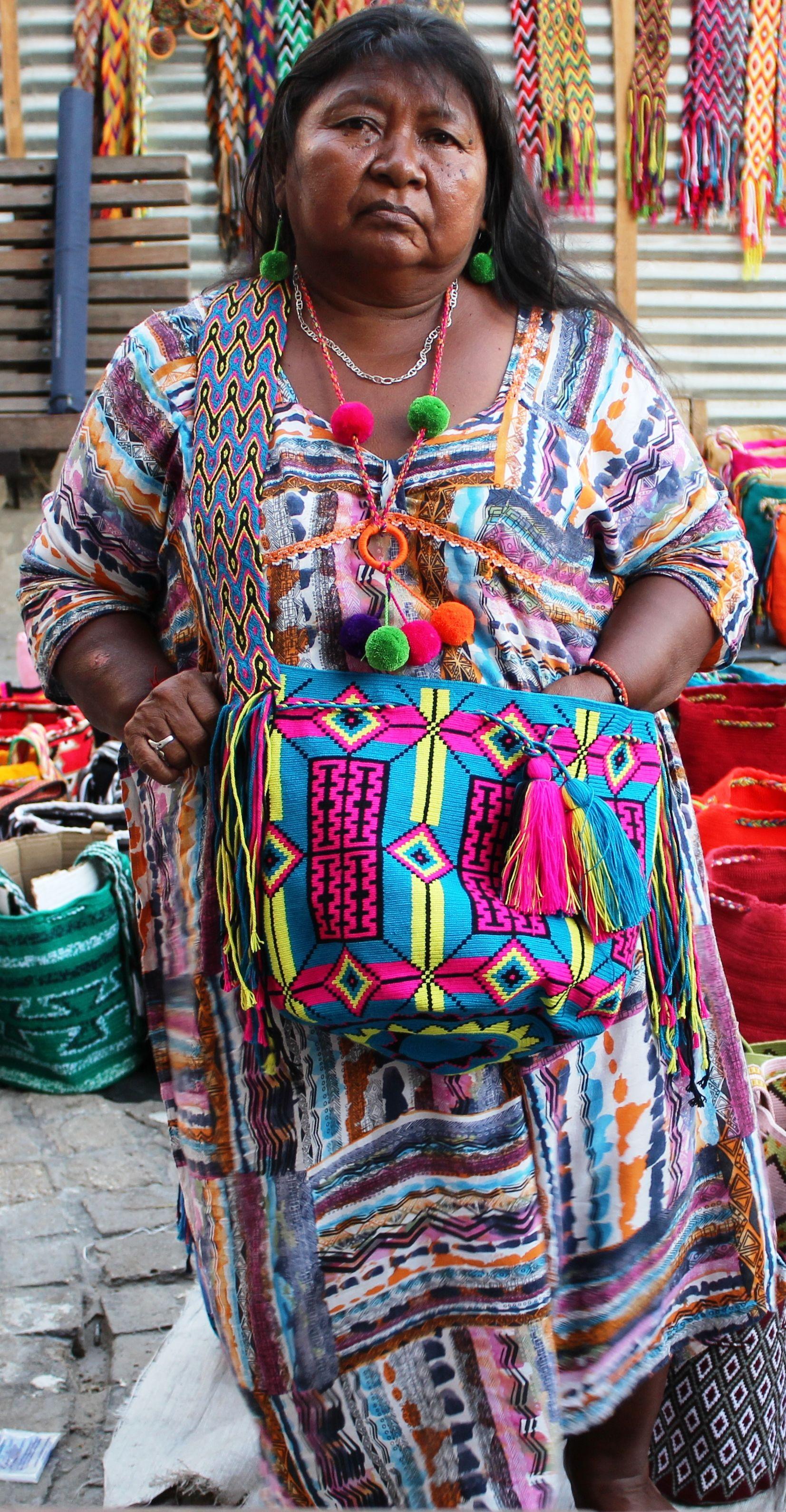 Wayuu Indian artesana Carmen wearing a traditional Wayuu dress, necklace, earrings and mochila