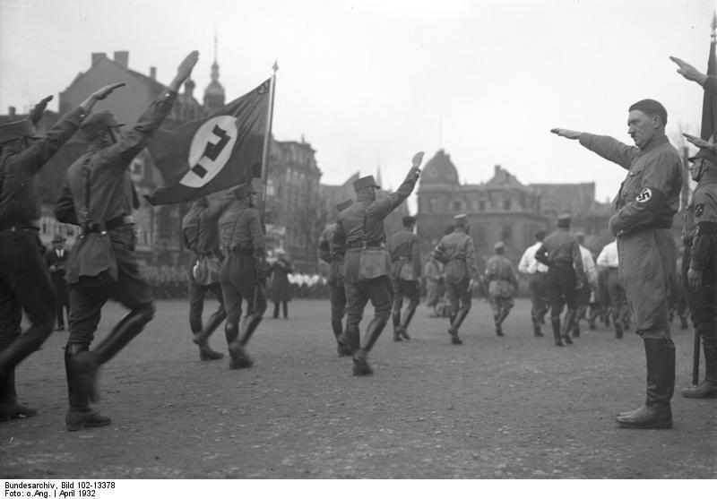 Adolf Hitler reviewing a Nazi SA parade, Braunschweig, Germany, Apr 1932