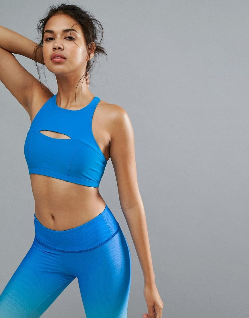 5ea92594db897 Get this Onzie s sports bra now! Click for more details. Worldwide  shipping. Onzie Blue Open Heart Bra - Blue  Gym bra by Onzie