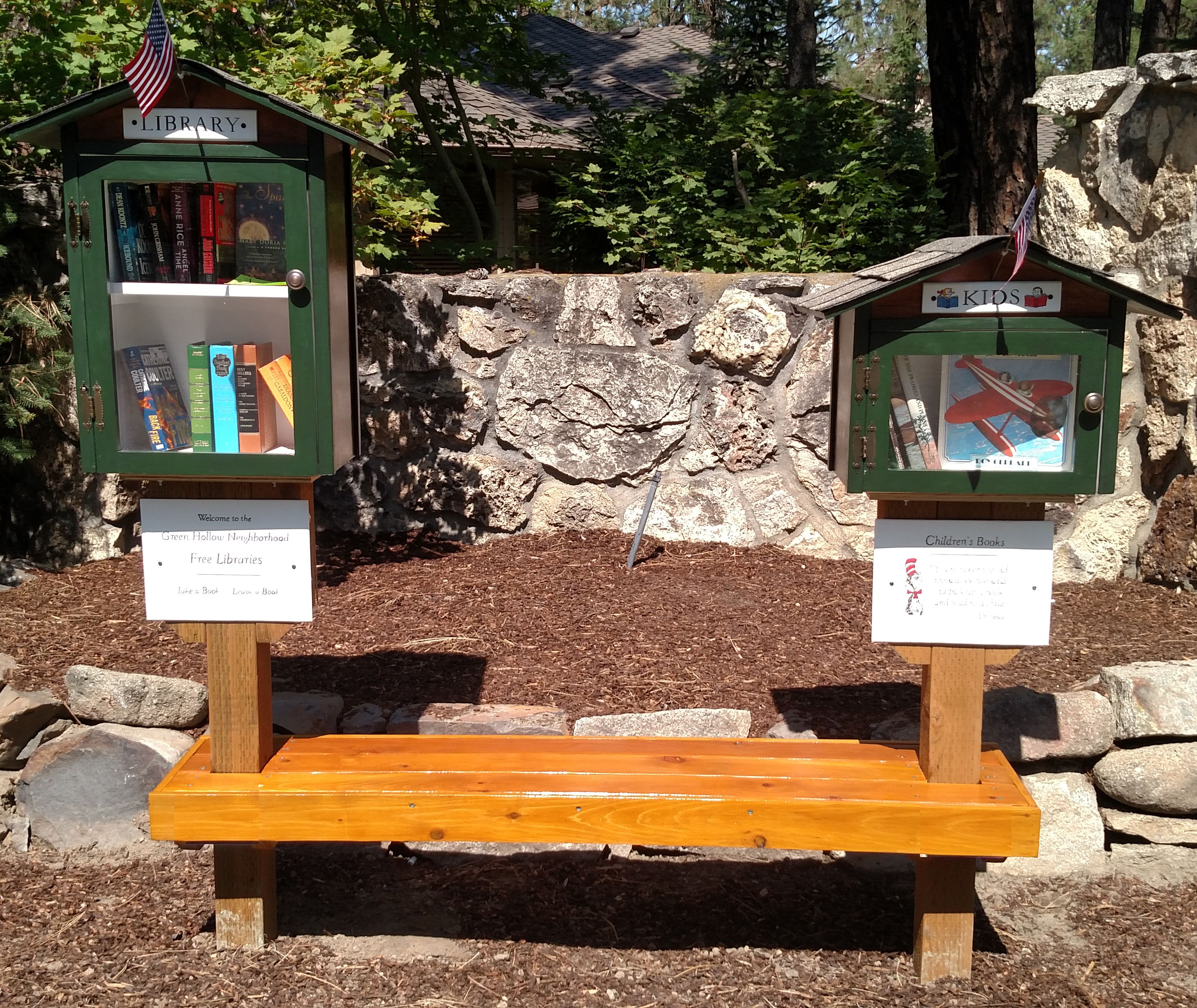 These little free libraries can be found on the corner of Waikiki and Hemlock at the entrance to the Green Hollow neighborhood. A two-story library for adults and a separate smaller library for children's books connected by a redwood and cedar bench. Way cool! Purchased and donated to the community by Stephanie Peterson of Windermere Real Estate. Built by Little Library Builder of Spokane!! littlelibrarybuilder@gmail.com