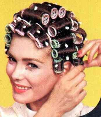 Curling your hair, 60s style  You ever try sleeping in those babies??