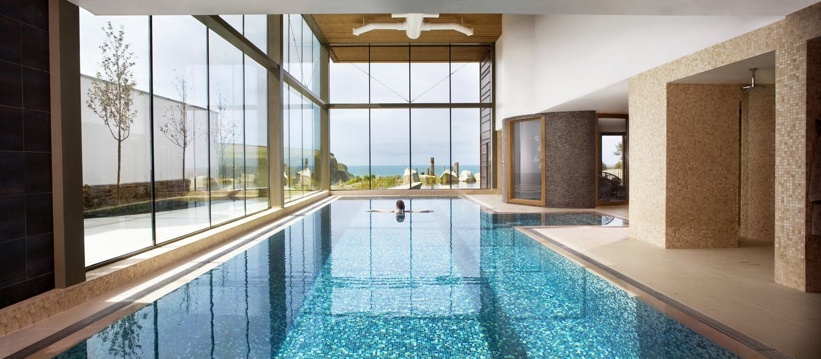 Cool Indoor Swimming Pools mesmerizing lengthwise indoor pool with cool blue-white mosaic