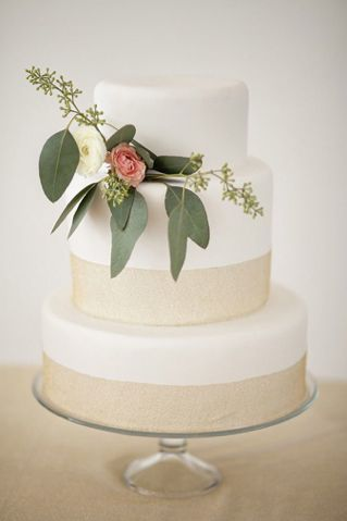 Neutral wedding cake with flower cake topper- love the seeded eucalyptus and roses.
