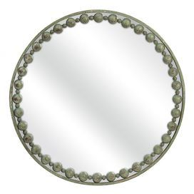 """Indulge in fresh springtime style with this eye-catching essential, an enviable addition to your living room or well-appointed master suite.Product: Wall mirrorConstruction Material: Iron and mirrored glassColor: Weathered greenFeatures: Classic orb patternDimensions: 32"""" Diameter        Shipping: This item ships small parcelExpected Arrival Date: Between 04/22/2013 and 04/30/2013Return Policy: This item is final sale and cannot be returned"""