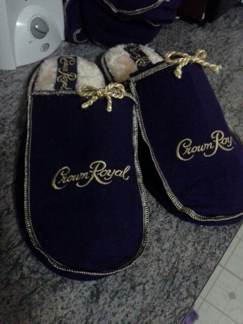 Crown royal slippers for wayne. Covered new slippers with c.r. bags and hot glued in place. Added trim from bags around the whole thing, and made the bows from the drawstring. :) proud of myself