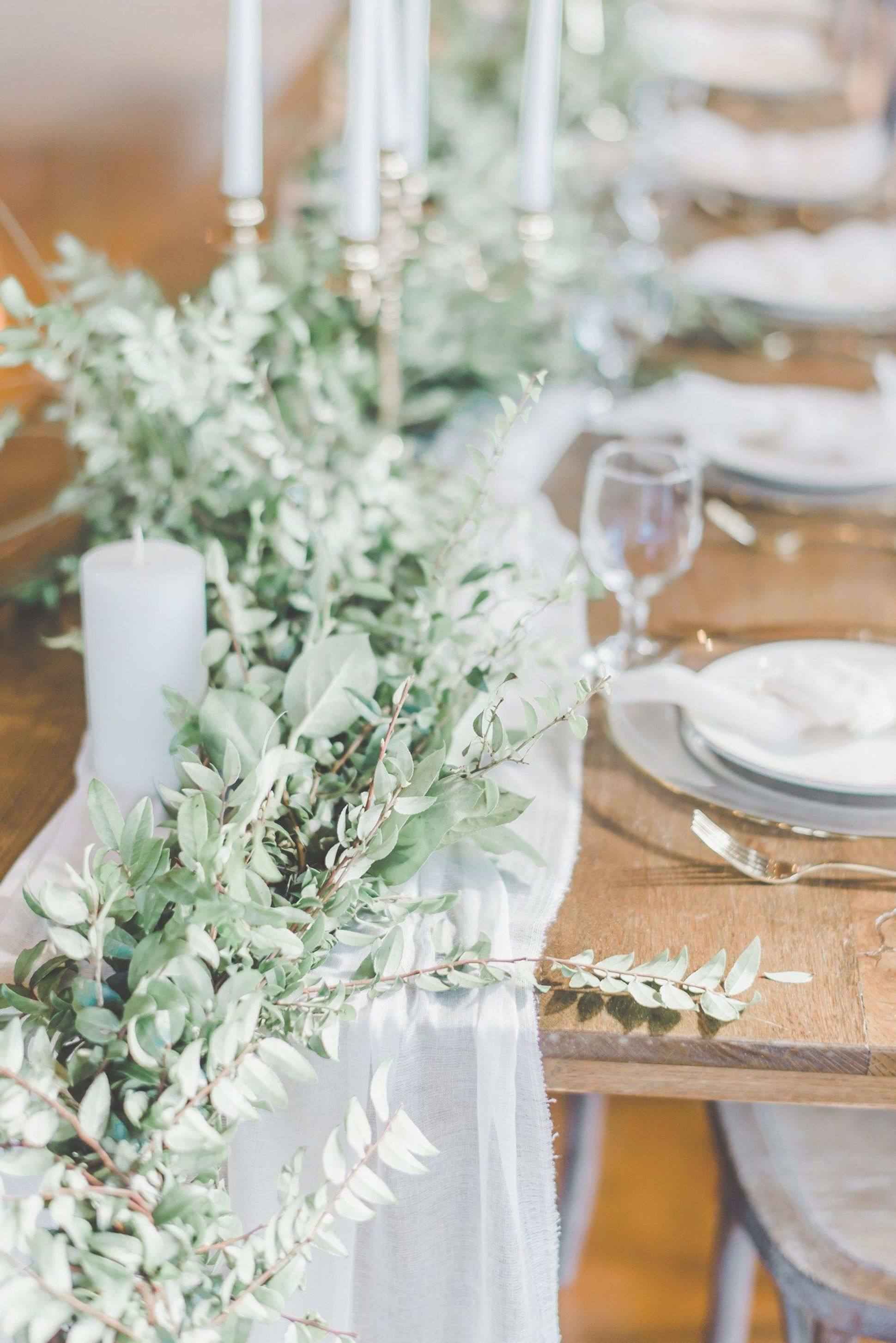 These Wood Farm Tables Featured White Gauze Cheesecloth Runners With Greenery Garlands Gold Cande In 2020 Table Runners Wedding Wedding Table Vases