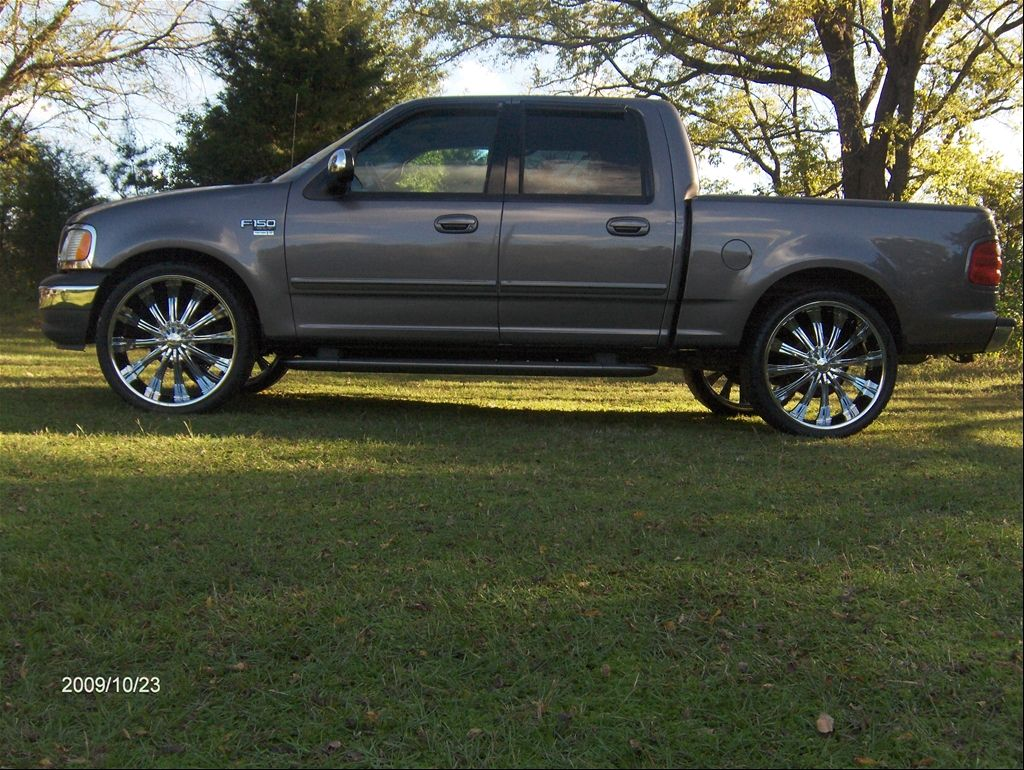F150 on 24 inch rims 2002 ford f150 supercrew cab blue flame