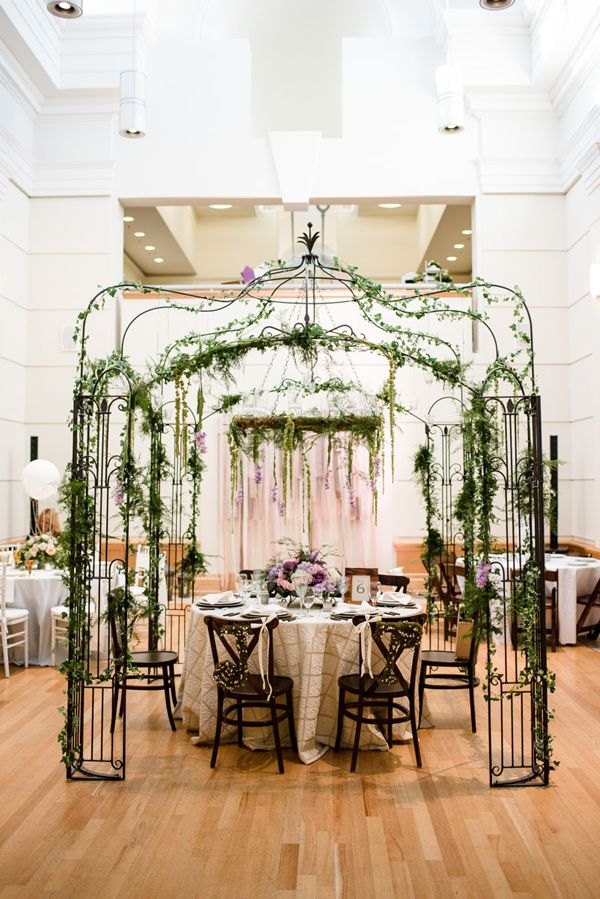 secret garden sweetheart table - photo by Emily Millay Photography http://ruffledblog.com/candy-colored-wedding-inspiration-in-charlotte #sweethearttable #weddingideas #reception