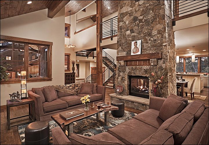 Stunning Living Room With A Gas Fireplace And Vaulted Ceilings